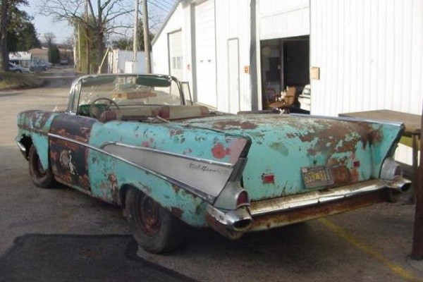 rusted-out-1957-chevy-convertible-rear-corner