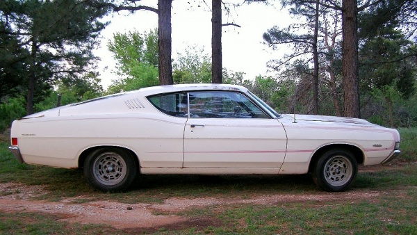 fenced-in-1968-ford-torino-gt-side-view