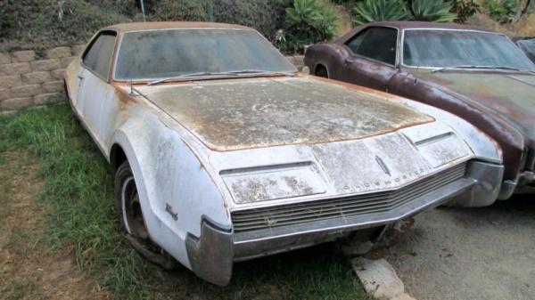 Rust Covered Oldsmobile Toronado