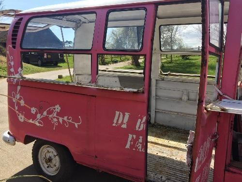 Pink bus right side door open