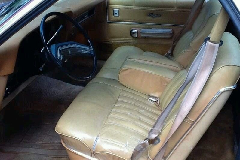 the seller mentions the brougham interior option and states that its leather the only reference material i could find said it was vinyldo any of you