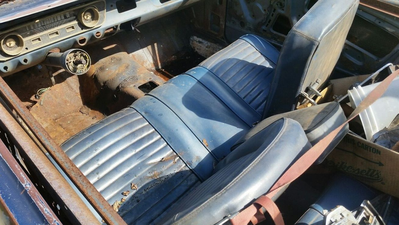 Heres a shot of the front bench seat most people opted for the buckets when ordering their mustangs so its an interesting option to find in such a