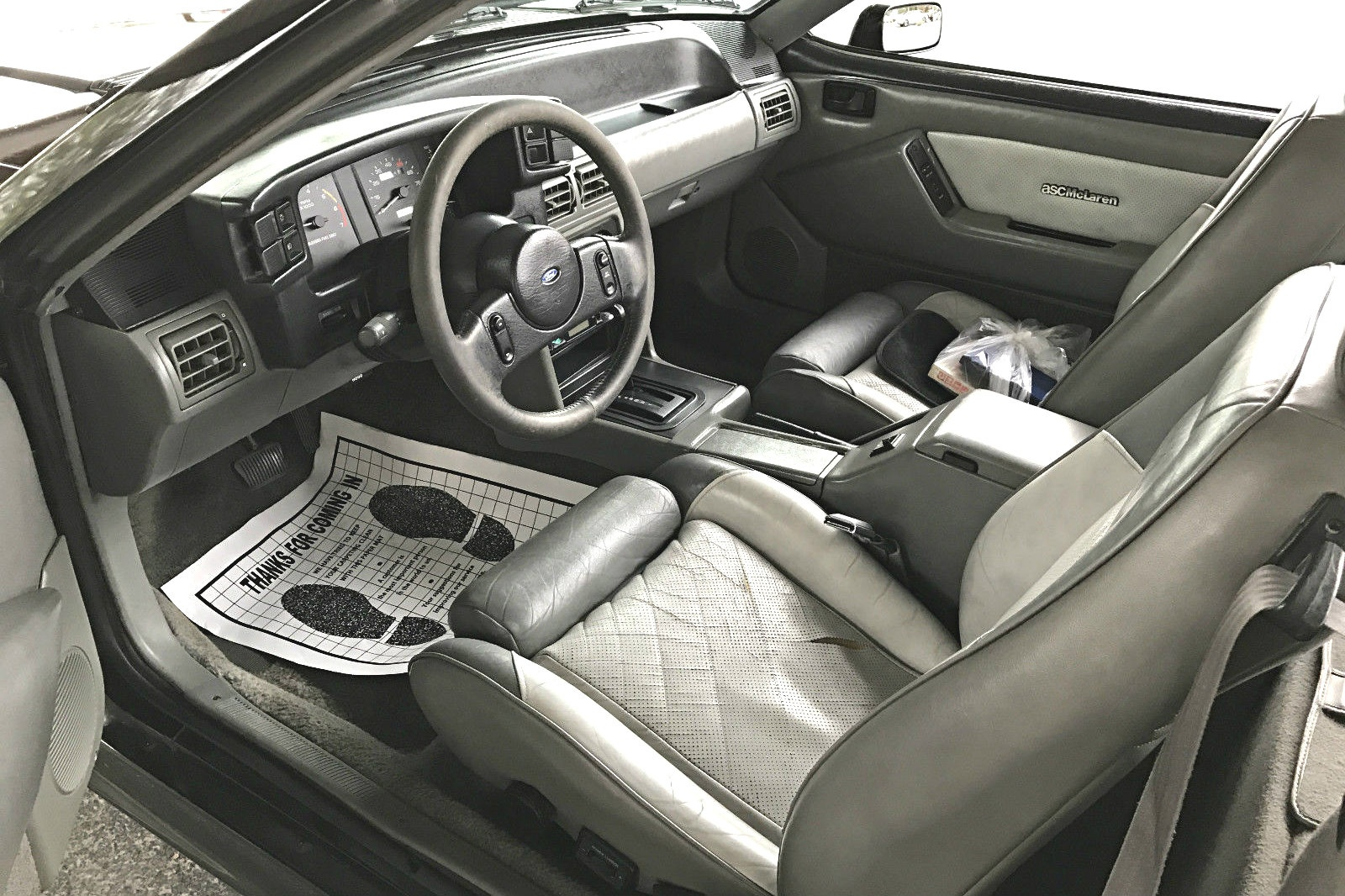 With A Typical Fox Body Earance The Interior Does Have Few Features That Are Mclaren Specific Seats And Door Panels Covered In Perforated