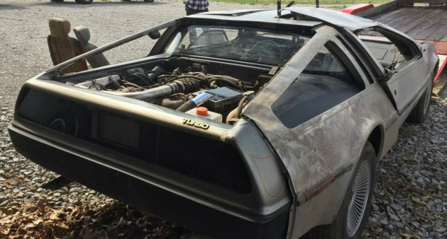 wrecked gullwings delorean project pair