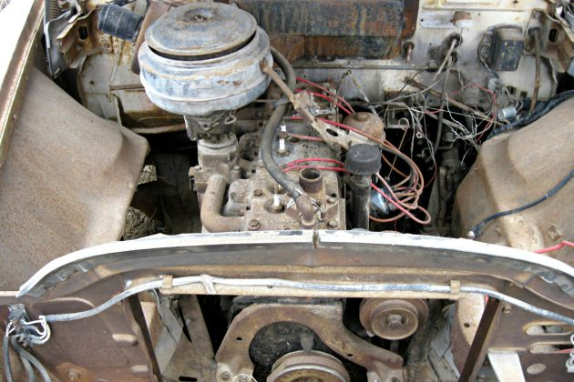 at a quick glance the engine compartment appears nice but the radiator is  missing, and the wiring harness looks a bit chaotic  the factory 265 cubic  inch l